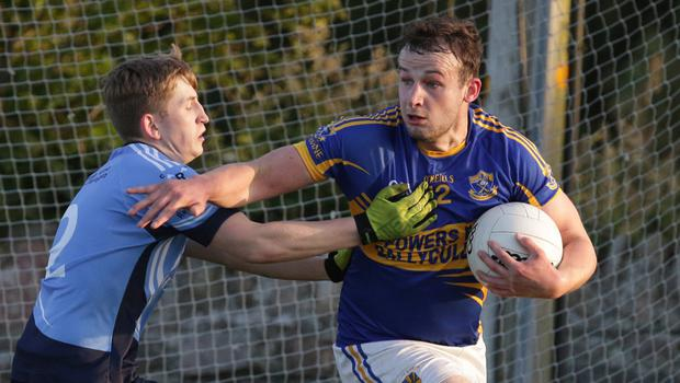 Barry Roche of St. Anne's tackling Gusserane's Darragh Doyle
