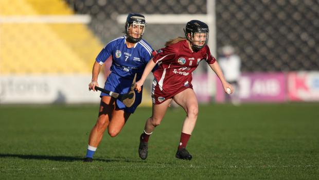 Leading scorer Chloe Foxe racing away from Thomastown defender Catherine Walsh