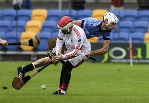 Glenealy goalkeeper Keith Snell stops Jonathan Fogarty of St. Anne's in his tracks