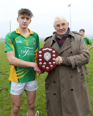 Diarmuid Doyle, the Hollow Rovers captain and top scorer, with Brendan Furlong of People Newspapers