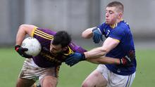 Conor Devitt is tackled by Wicklow's Darragh Fitzgerald during Saturday's derby in Aughrim