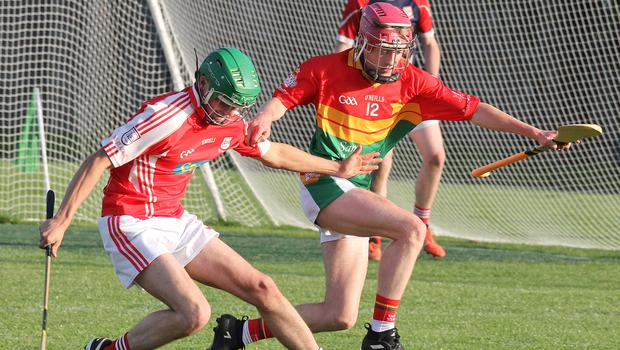 Willie Bolger of Ferns St. Aidan's and Michael Dempsey (Rapparees) in a battle for the ball