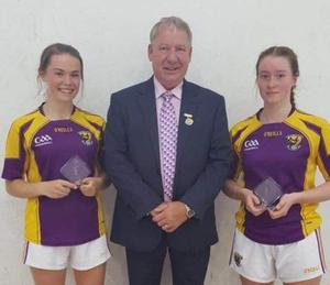 Handball President Joe Masterson with Under-17 runners-up Eva Crean and Cliodhna O'Connell