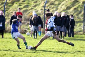 Byron Mac Suibhne of Meanscoil Gharman in a tussle for possession with Duiske College attacker Jason McGrath