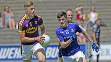 Centre-back Ronan Devereux on the move away from Longford's Iarla O'Sullivan