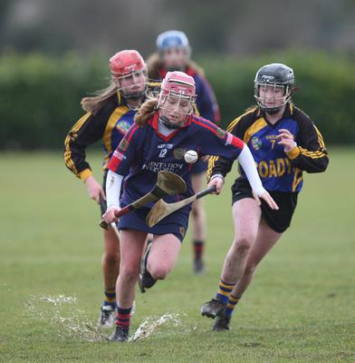 Ailis Neville makes a piercing run through the Castlecomer defence as Caoimhe Hennessy looks on