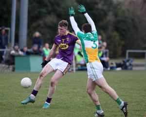 Nick Doyle shoots as Offaly defender Paul McConway tries to block