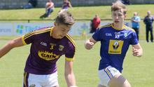 Full-back Gavin Sheehan on the move out of defence as Wicklow's Cian Lee looks on