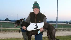 George 'Bombers' O'Connor, the former Wexford football goalkeeper, with race three winner Related Len