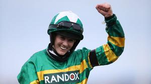 Rachael Blackmore celebrates after winning the Randox Grand National on board Minella Times