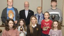 At the Taghmon Athletics Club annual awards presentation in the G.A.A. clubhouse were - back (from left): Devan Colfer (Spirit of the Club award), Paddy Greene, May Buttimer, James Hanlon (special achievement award). Front (from left): Gráinne Kelly (best Senior athlete), Sophie Creane (best Junior attendance), Aisling Kelly (athlete of the year), Izzy Aspel (special merit award), Irla Kelly (most improved athlete)