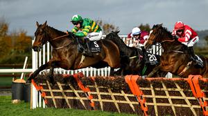 Cayd Boy and Mark Walsh clearing the last on their way to a win in Down Royal last October. Photo by David Fitzgerald / Sportsfile