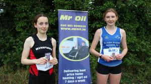 Ailbhe White (silver) and Orlaith Deegan (gold) after the girls' U17 highjump