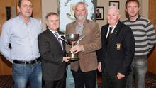 Minister Brendan Howlin TD presents the Howlin Cup to Nicky Lacey (winner) in Wexford Golf Club as Pat Murphy, Clem Daly (Captain) and Andy Lehane (for Denis Lehane) look on
