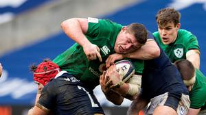 Tadhg Furlong is held up by Scotland's George Turner during Sunday's win in BT Murrayfield. Photo by Paul Devlin / Sportsfile