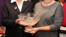 Lily English, lady President in New Ross (left), presents the Lady golfer of the year award to Ger Mackey