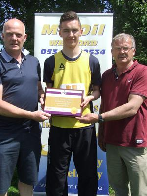Ciarán Mooney of MrOil presenting the athlete of the month for May to Ryan Carthy-Walsh of Adamstown A.C., with Paddy Morgan, Chairman of Athletics Wexford. Ryan received the award for winning the Leinster and All-Ireland Schools championships in the high jump and achieving the European Youth Olympic standard of 2.03m.
