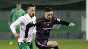 Conor Crowley keeps the ball away from Alex Aspil (Cabinteely)