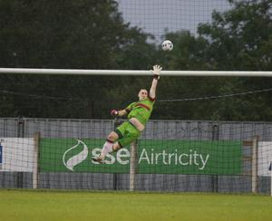 Netminder Corey Chambers is kept on his toes by this rising shot from a Limerick rival