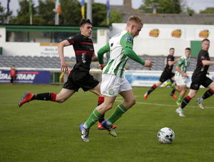 Wexford FC full-back Lee Costello gives chase to Bray Wanderers winger Dean O'Halloran