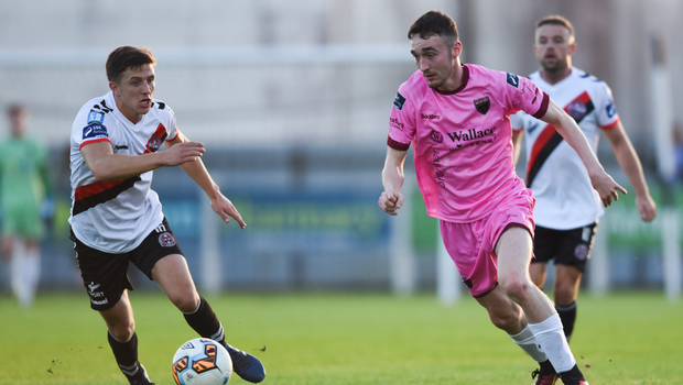 Dean George tries to steal a march on Bohemians midfielder Keith Buckley during Friday's rout in Ferrycarrig Park