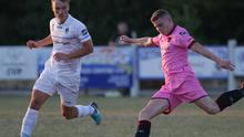 Mark Slater of Wexford F.C. on the ball as Greg Sloggett (U.C.D.) closes him down