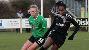 Blessing Kingsley of Wexford Youths is tracked by Claire Walsh.