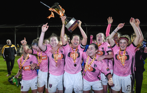 Wexford captain Kylie Murphy lifts the Continental Tyres Women's National League trophy to the delight of her team-mates