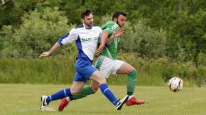 Nigel Usher of Glynn Barntown and Forth Celtic's Pádraig Rossiter battle for possession during their Tier 1 Group C match on Sunday (20th)
