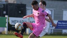 Wexford F.C. midfielder Thomas Croke protects the ball from Evan Farrell of U.C.D