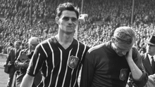 A PIECE OF HISTORY: After helping Manchester City win the FA Cup against Birmingham City, goalkeeper Bert Trautmann leaves the field rubbing his'sore' neck. It later transpired he had broken it