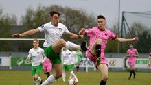 Dean George of Wexford FC battling for possession with Cabinteely full-back Karl Byrne