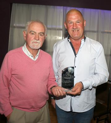 The Services to Football Award 2018-'19 being presented to Tommy Breen of Ferns United by Daire Doyle, Chairman of the Wexford Women's Soccer League
