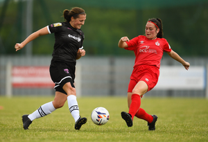 Edel Kennedy of Wexford Youths in a midfield tussle with Alannah McEvoy