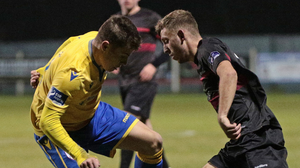 Charlie Smith of Wexford FC tries to cut inside and evade Longford Town's Aaron McNally