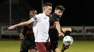 Karl Fitzsimons gets a foot to the ball before Cobh's Lee Devitt