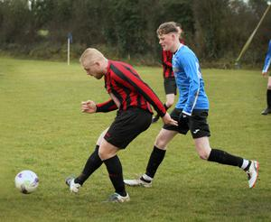 Joe Bolger of Gorey Rangers is tracked by James Fleming of Courtown Hibs.