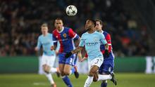Raheem Sterling of Manchester City keeps his eyes on the ball during their hammering of Basel