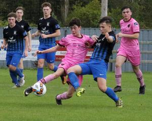 Ciarán Paige of Wexford F.C. battling against Callum McKelvey of Athlone Town