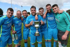 Kyle Dempsey, Adam Beary, Alan Rhodes, John Lester, Craig McCabe, Gary Delaney and Noel Heffernan with the cup