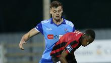 Craig McCabe of North End United puts pressure on Babatunde Animashaun of Longford Town.
