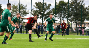 Stephen Kinsella of Gorey Rangers shoots to score his side's second goal against Usher Celtic
