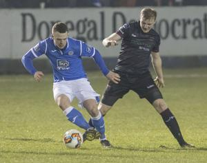 Ciarán O'Connor of Finn Harps tries to give Wexford F.C. defender A.J. Lehane the slip