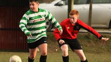 Jakub Kaspirowicz (Gorey Celtic) and Lee Connors (Camolin Celtic)