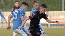 Dean George nicks the ball away from Niall McGinley of Finn Harps close to the sideline