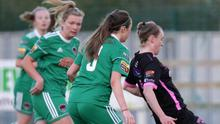 Danielle Burke of Cork City closes in on Claire O'Riordan of Wexford Youths