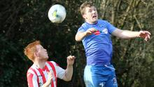 Aaron Collier of Bunclody and Kyle Dempsey of North End United battle for the ball in the air