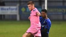 Liam McCartan in action against George Mukete of Athlone Town