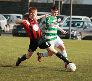 Paul Brennan of Gorey Rangers tackling Castlebar Celtic's Jason Hunt in the last round of the FAI Junior Cup in early March. The quarter-final, away to Usher Celtic from Dublin, is fixed for Sunday, July 26.