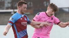 Danny Doyle of Wexford F.C. battling for the ball with Drogheda United's Luke Gallagher